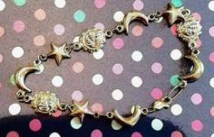 Check out this item in my Etsy shop https://www.etsy.com/listing/473394237/girls-sun-moon-and-stars-bracelet-in