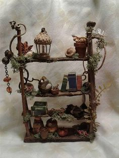 This rustic fairy house bookshelf can be personalized just for you! The one pictured is about 5 inches tall and 3 inches wide, but can be made other sizes as well. You can even make some choices as to what you would like on the shelves. I make all of the miniatures myself. The one