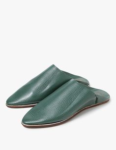 Moroccan-inspired, slip-on slides in Dark Green. Pointed toe. Leather lining. Padded footbed with embossed graphic. Tonal stitching.   • Leather upper • Mahogany outsole • Made in Morocco • Women's sizes listed  Note: Please see sizing tab for deta