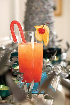 Jingle Juice Ingredients  5 cups orange juice 1 cup vodka 1/3 cup orange liqueur 1/4 cup fresh lemon juice 1/2 cup maraschino cherry juice Garnishes: fruit-flavored candy cane sticks, cherries with stems, orange and lemon slices Preparation  1. Stir together orange juice and next 4 ingredients; serve over ice. Garnish, if desired.