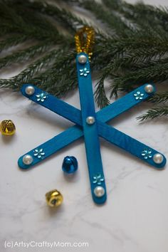 No two snowflakes are alike, and our DIY Popsicle Stick Snowflake Ornament is also one of its kind! Make them in different colors to brighten up your tree! Popsicle Stick Snowflake, Popsicle Stick Christmas Crafts, Christmas Crafts For Kids To Make, Popsicle Stick Crafts, Christmas Ornament Crafts, Craft Stick Crafts, Diy Christmas Gifts, Kids Christmas, Holiday Crafts