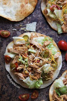 Loaded seasoned chicken tacos on a puffy fried tortilla. Recipe by @Rachel {Baked by Rachel}