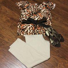 HPANNE KLEIN ANIMAL PRINT BLOUSE Beautiful earthy colors and a flowy material will make this a favorite for your summer wardrobe.. Excellent condition Anne Klein Tops Blouses