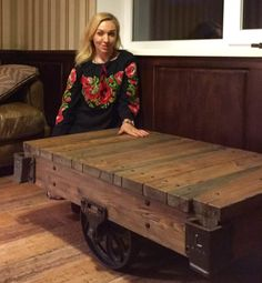 Wow! Kiev, Ukraine interior designer Iryna and her Lineberry factory cart replica coffee table created for her client's home. Constructed of salvaged lumber from a 100-year-old mill 300 miles outside Kiev. Iron Anarchy acquired all the antique iron hardware- wheels, axle brackets, end casters and corner stake brackets.