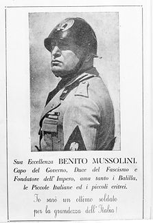 "Propaganda poster of Benito Mussolini, with caption ""His Excellency Benito Mussolini, Head of Government, Leader of Fascism, and Founder of the Empire...""."