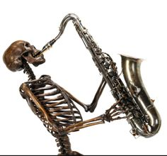 These skeletons playing instruments are ideas for hand tattoos. 2 needed. ✌