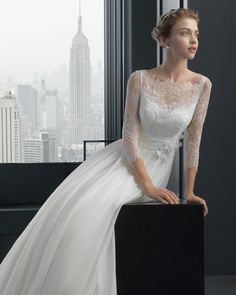 Long-sleeved lace wedding gown.