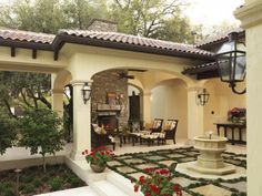 Beautiful courtyard, fireplace, and seating.