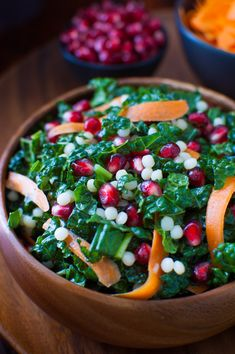 Pomegranate, Israeli Couscous, Carrot and Kale Salad with Honey-Lime Vinaigrette - a light and healthy kale salad with punches of flavor from pomegranate seeds and a zesty honey-lime vinaigrette from tamingofthespoon.com