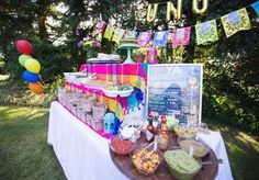"Food Table at a Fiesta First Birthday Party - love those gold Mylar ""Uno"" balloons!"