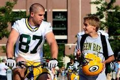 Jordy doing the Green Bay Packers Bike Tradition