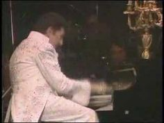 Liberace...I watched his show as a four year old and loved it!!