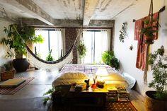 Gorgeous bedroom with hammock- modern bohemian design