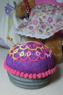 Cute pin cushion using a lid from an antique Mason jar.