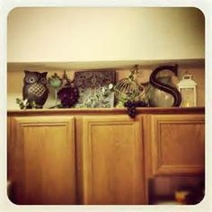nice way to decorate top of a cabinet.. rusty heart designs