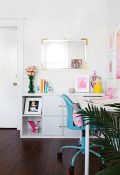 bright and colorful office decor with white and gold details
