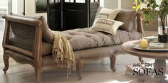 I love this french inspired cane sides sofa/daybed. The vintage finish and cabriolet legs are tres chic!