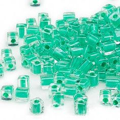 Seed bead, Miyuki, glass, clear color-lined green, (SB219), 3.5-3.7mm square. Sold per 25-gram pkg.