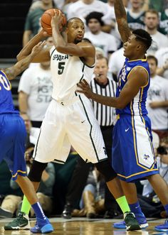 Nov 8, 2013; East Lansing, MI, USA;Michigan State Spartans center Adreian Payne (5) posts up against the McNeese State Cowboys in the first half a game at Jack Breslin Student Events Center. Mandatory Credit: Mike Carter-USA TODAY Sports