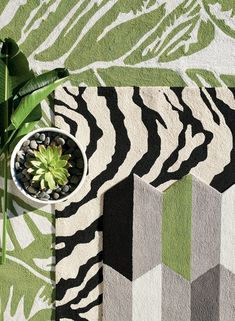 The oversized graphic on our Banana Leaf Indoor/Outdoor Rug creates a dynamic pattern similar to shadows cast on a jungle floor. The hand-tufted loop pile is made using durable, fade-resistant polypropylene/acylic blend that creates a plush texture that will retain both its color and its design for years.