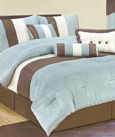 7-Pc. Reflection Bed Sets 2 pillow shams, the 3 accent pillows and comforter (KING) Aqua/brown color. $59.95