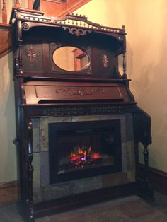 Pump organ electric fireplace
