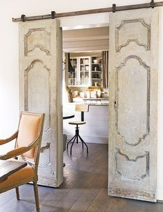 These sliding doors, on a barn door frame, add architectual interest, close off the kitchen without taking up floor space and then you can pretend the untidy meal prep is not there while you entertain. k