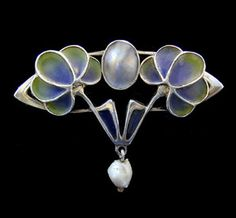 This is not contemporary - image from a gallery of vintage and/or antique objects. LEVINGER & BISSINGER A Jugendstil silver plique-a-jour brooch set with a central blister pearl plaque and with a pearl drop.