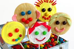 M&M'S Happy Face Pops   Prep Time: 15 Min.   Bake Time: 12-14 Min.   Decoration Time: 20 Min.   Difficulty: Easy   Yield: Makes 12 Cookies      ¼ cup M&M'S® Brand Chocolate Candies   1 package (18-oz) prepared sugar cookie dough   1 tablespoon flour   Food coloring   1 tube decorative white icing   12 (6-inch) lollipop sticks   1 (3-inch) round cookie cutter   12 pieces STARBURST® Fruit Chews, optional   1 container white frosting, optional      1. Roll the cookie dough to ¼-inch th...
