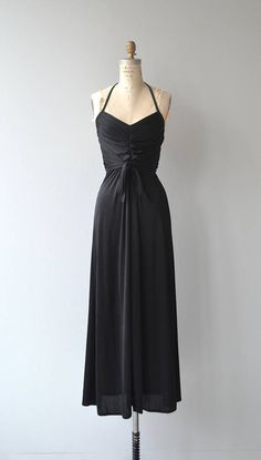 Vintage 1970s jet black polyester maxi dress with halter ties, ruched bodice, fitted waist, tie front waist and back zipper. --- M E A S U R E M E N T S --- fits like: xs/small bust: 32-34 waist: 25-27 hip: up to 44 length: 52 brand/maker: Shawn Originals condition: excellent to ensure a good fit, please read the sizing guide: http://www.etsy.com/shop/DearGolden/policy ✩ layaway is available for this item ✩ more vintage dresses ✩ http://www.et...