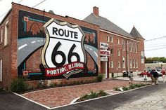 The Route 66 shield mural captured by Lam Lam Friedrich. This painted shield is the largest Route 66 shield in the world and one the oldest murals in Pontiac, Illinois. Route 66 Attractions, Route 66 Sign, Old Route 66, Route 66 Road Trip, Historic Route 66, Travel Route, Travel Usa, Travel Info, Wisconsin