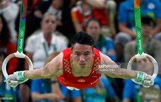 TOPSHOT - China's Deng Shudi competes in the rings event of the men's team final of the Artistic Gymnastics at the Olympic Arena during the Rio 2016 Olympic Games in Rio de Janeiro on August 8, 2016. / AFP / Thomas COEX