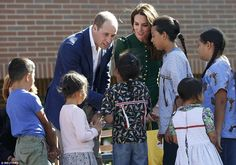 The duke and duchess received gifts from local children during a welcome ceremony at the university campus