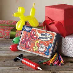 """BALLON ANIMALS KIT--Old-fashioned fun, just as cool now, this balloon modeling kit includes 32 bright balloons, eye stickers, hand pump and instructions. Retro-printed gift box. Imported. 9-3/4""""W x 1-1/2""""D x 6""""H."""
