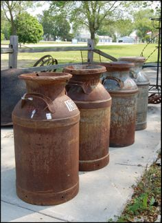 rusty milk cans