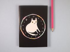 lined A6 cat notebook  This A6 notebook is made from recycled paper, featuring 48 pages of lined paper for you to fill with lists, doodles, notes,