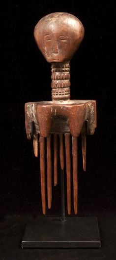 Africa | Carved wooden comb from Ghana | ca. early to mid 20th century.  Art Experience NYC  www.artexperiencenyc.com/social_login/?utm_source=pinterest_medium=pins_content=pinterest_pins_campaign=pinterest_initial
