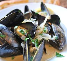 Mussels in a white wine broth. This isn't necessarily the recipe that Marcus uses. He's made it so many times, it's like second nature to him. So I just found a photo that resembled his finished product.