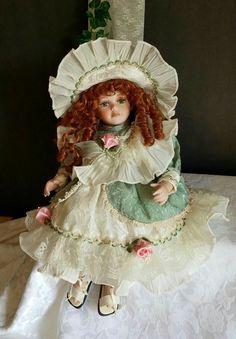 Vintage Porcelain Doll Doll in Green Dress by OurVintageNest