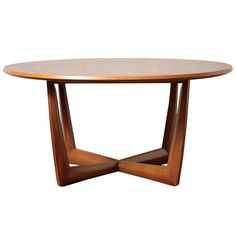 Round Danish Teak Coffee Table | From a unique collection of antique and modern coffee and cocktail tables at http://www.1stdibs.com/furniture/tables/coffee-tables-cocktail-tables/