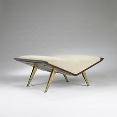 Lot 109: Gio Ponti. bench. 1953, brass, walnut, upholstery. 37 w x 31½ d x 17 h in. result: $22,420. estimate: $5,000–7,000. Literature: Gio Ponti: The Complete Works, Ponti, pg. 161.