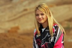 Ashely Fiolek.  Arguably the best female motocross rider on the planet, and completely deaf. Amazing girl