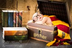 Baby Dylan had no problem playing the part for his newborn session. 11 days old and has mommy and daddy under his spell already. I'd love to capture your little one with a theme that represents you. Jennifer @sithappy #harrypotterfan    Photography, Photographer, Harry Potter, newborn photo, baby wizard books wand glasses scarf sithappy