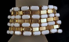 Hobe' Wide Gold-tone Faceted Milk Glass Bracelet