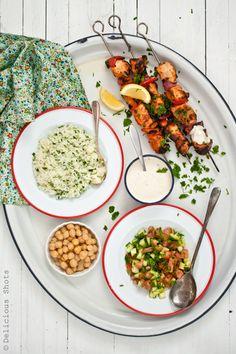 Grilled chicken kebabs, herbed jasmine rice, salad, lemony chickpeas and yogurt-tahini sauce