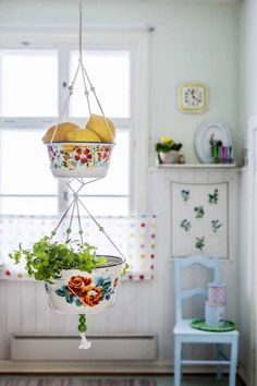Hanging vintage bowls as baskets - such a sweet kitchen touch.