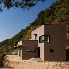 House in Sang-an by Studio GAON designed to suit a couple with three dogs