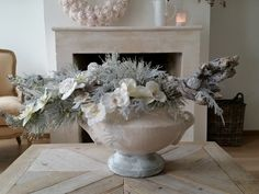 Winter centerpiece of natural branches and silk flowers