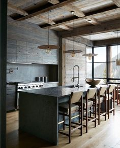 This mountain modern ski house was designed by Pearson Design Group and Shawn Henderson, located in the Yellowstone Club, Big Sky, Montana. Interior Exterior, Interior Design, Modern Cabin Interior, Modern Cabins, Stone Kitchen, Cuisines Design, Home Kitchens, Rustic Cabin Kitchens, Rustic Cabins