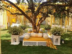 Check out mehendi décor ideas from real Indian wedding celebrations. From genda phool to dreamcatchers and whatnot- these mehendi décor ideas are goals! Desi Wedding Decor, Wedding Stage Decorations, Tree Decorations, Wedding Ideas, Pakistani Wedding Decor, Moroccan Wedding, Wedding Favors, Diy Wedding, Rustic Wedding